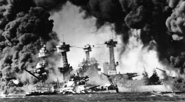 Battleship USS West Virginia sunk and burning at Pearl Harbor on Dec. 7, 1941. In background is the battleship USS Tennessee.